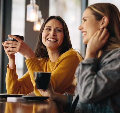 Women laughing at coffee shop